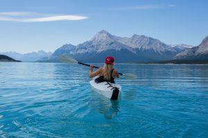 A Girl Paddling a Canoe
