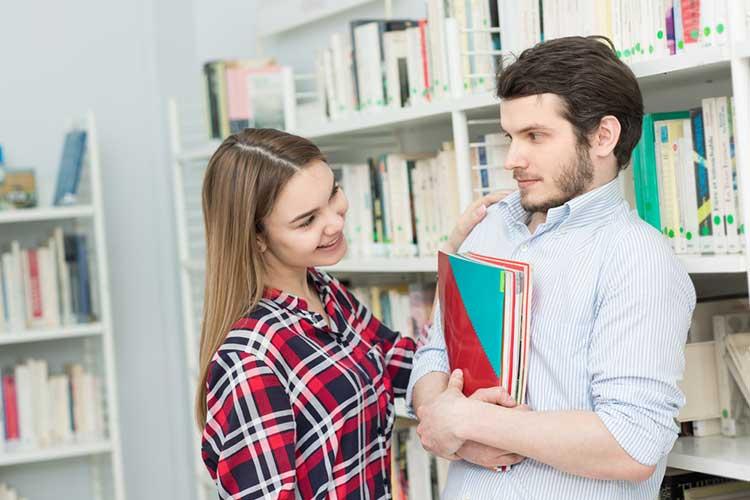Lady flirting with a shy guy