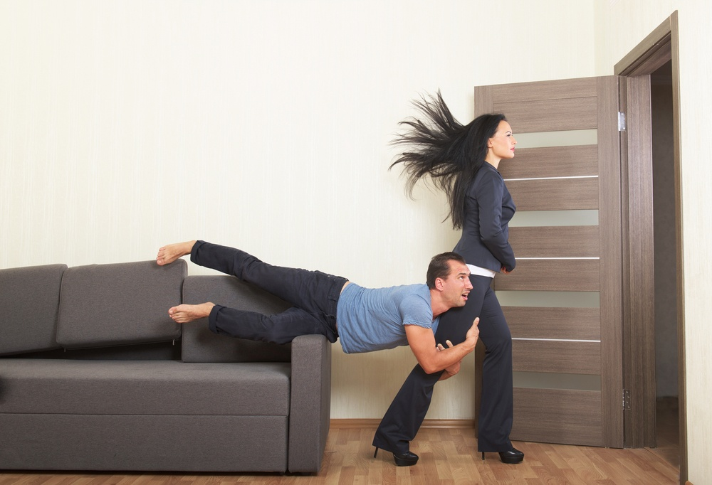 Man clinging to a woman desperately