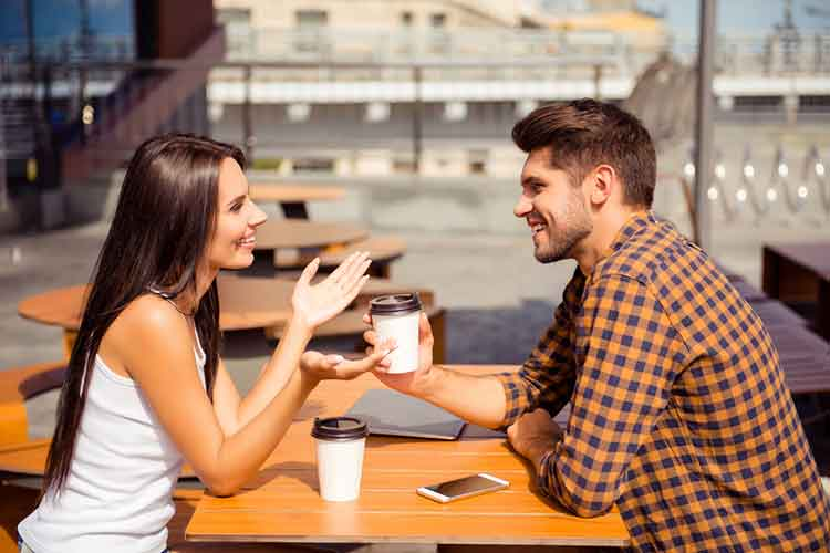 Guy conversing with a girl