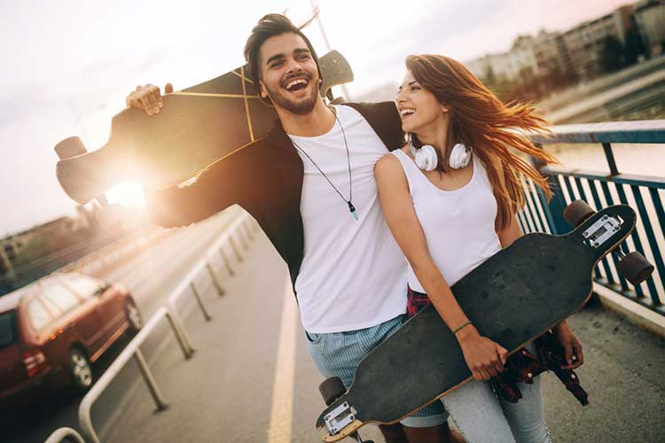 Couple skateboarding