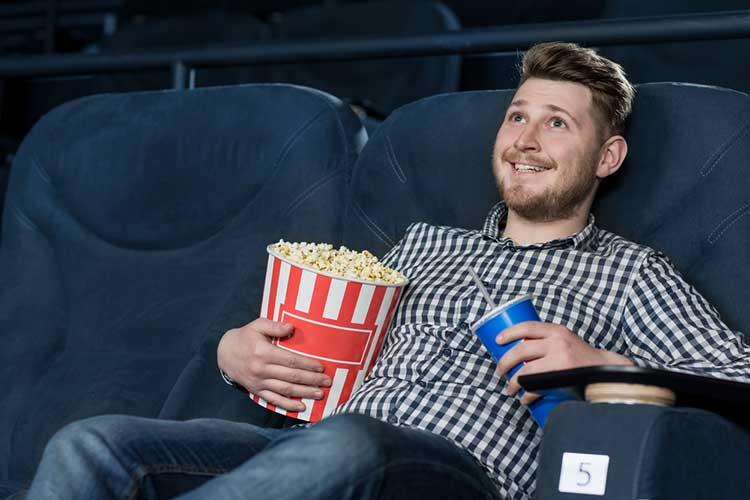 Guy in cinema alone