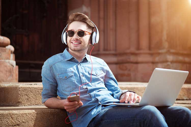 Guy listening to music