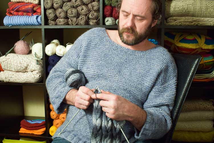 man in his 50s sewing