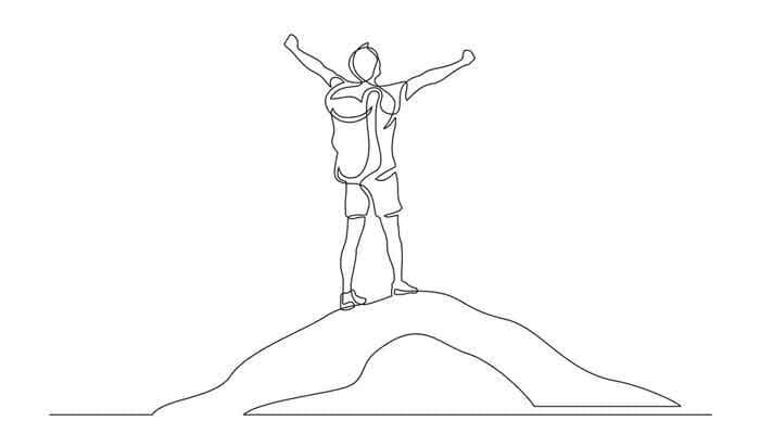 Man on mountain peak