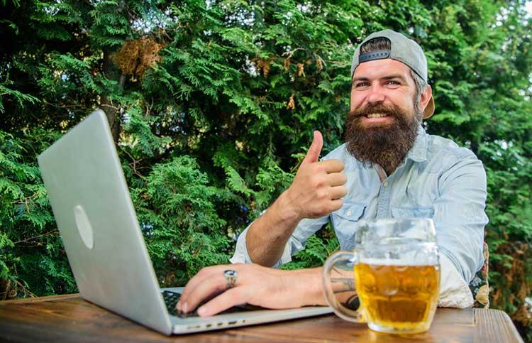man smiling and blogging