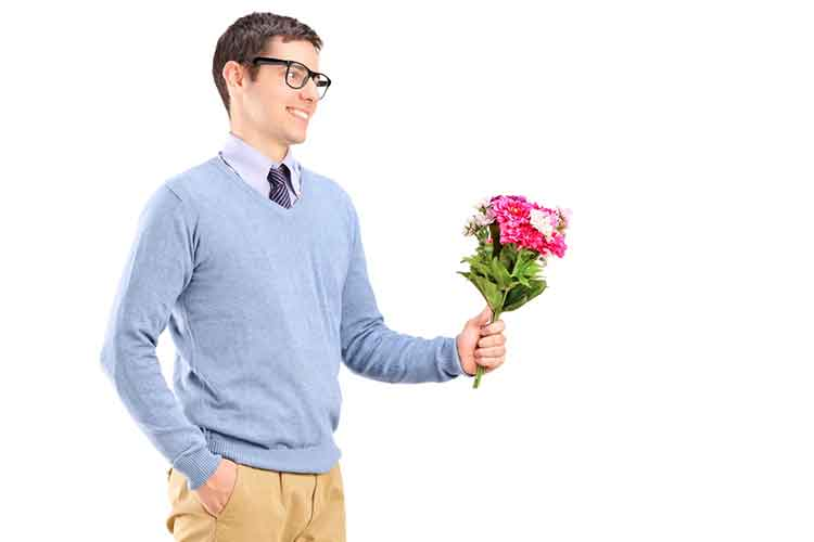 Guy holding flower