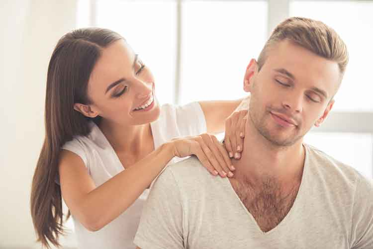 Lady shoulder massaging boyfriend