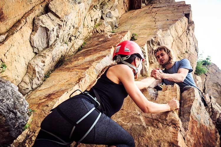 couple climbing rock