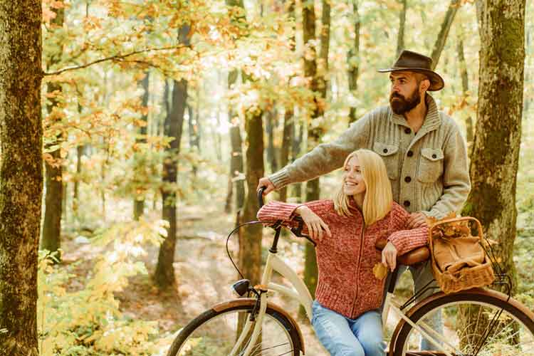 couple holding bicycle