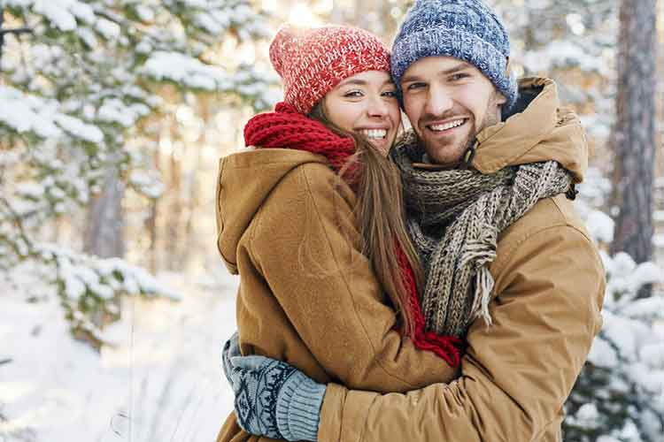 couple holding each other during winter
