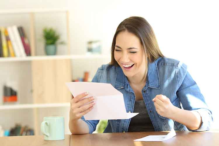 lady happy after opening letter