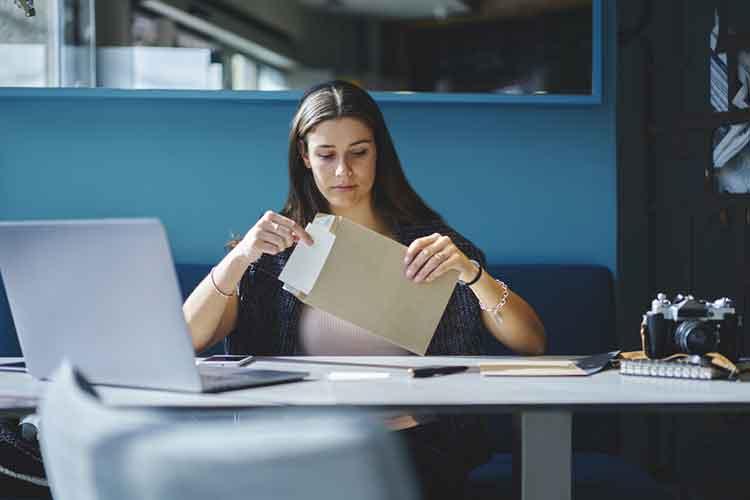 lady opening an envelope