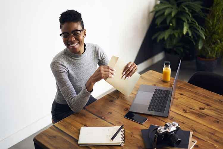 lady opening an envelope at work