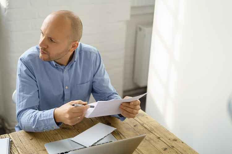man opening an envelope