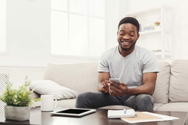 man sending good morning text to lover