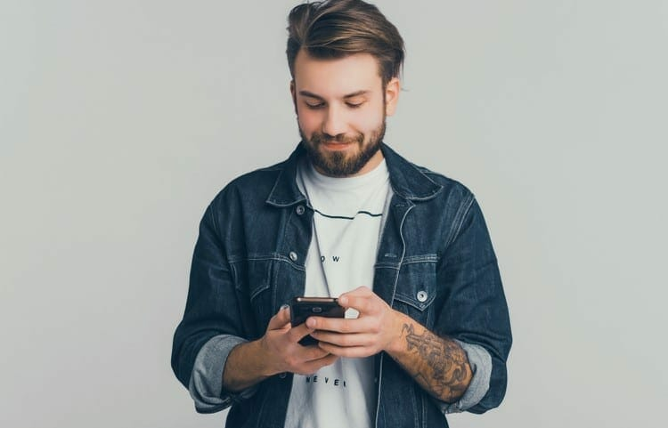 smiling guy sending text