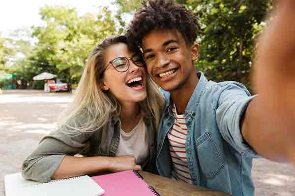 Teenage couple smiling
