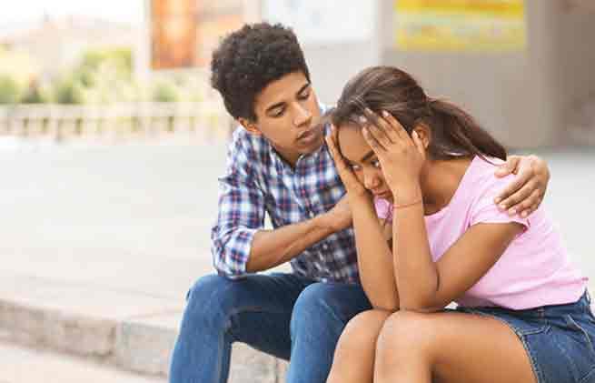Guy consoling sad girl